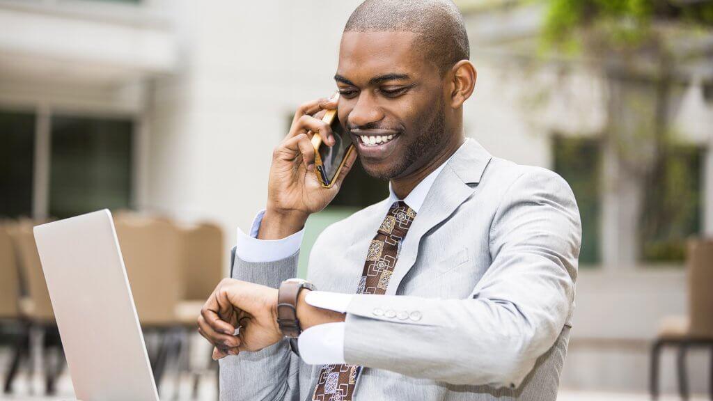 MAIN-businessman-looking-at-phone-1024×576